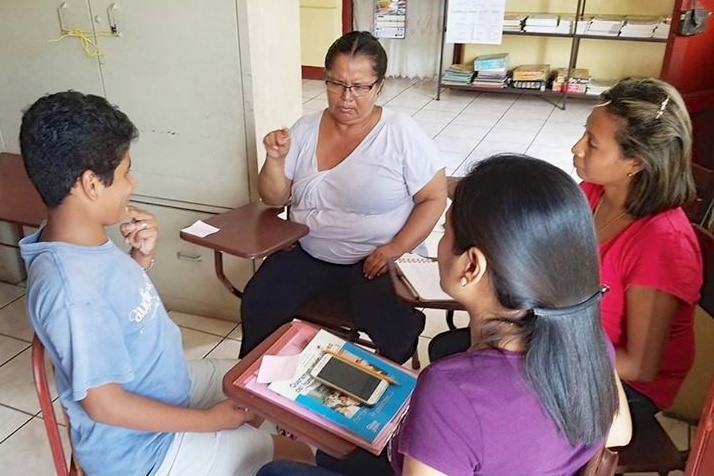 Yadir, one of the Deaf students at the school, is teaching mothers to use Nicaraguan Sign Language for conversations with their families.